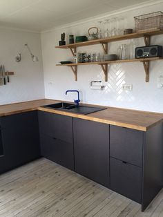 How to Paint Kitchen Cabinets Using Melamine Paint Lovely I Like the Wood Counte. How to Paint Kitchen Cabinets Using Melamine Paint Lovely I Like the Wood Counter and Black Cabinet but Id Put A White Sink, Black Kitchen Cabinets, Painting Kitchen Cabinets, Kitchen Paint, Black Kitchens, Cool Kitchens, Grey Cabinets, Kitchen Backsplash, Kitchen Wood, Black Ikea Kitchen