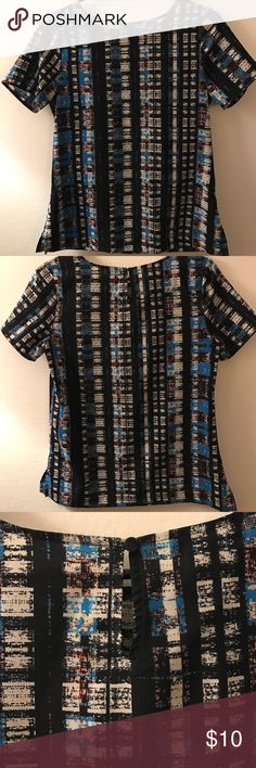 Blue and White Plaid Blouse A plaid blouse with light and navy blue, as well as white colors. Has a button in the back. Completely opaque-not see through. Is a size XS but fits like a size Small due to its loose design. Comes from Van Heusen. Van Heusen Tops Blouses