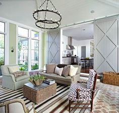 Lots to love here, note the herringbone brick floor and sliding barn doors.