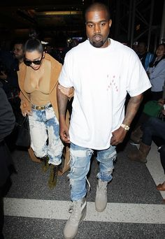 Kim Kardashian and Kanye West share everything! The pair dressed alike in acid wash jeans. Get the details of their constant outfit coordination!
