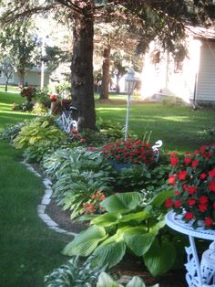 """Hosta Garden: Really like how they used containers and """"things"""""""