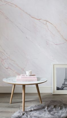 Transform your living room spaces with this effortlessly chic marble wallpaper. This texture wallpaper oozes elegance and makes for the perfect backdrop to modern living rooms. The slight pink hue adds a feminine touch that is refined and classy.