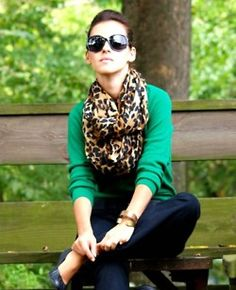 leopard print scarf, kelly green sweater, and dark jeans