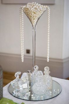 Divine Art Deco Centerpiece with overflowing pearls in a tall glass!  #Weddings - #Wedding Great #Gatsby & Art #Deco Styles!