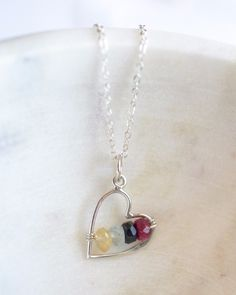 Custom birthstones silver necklace for mom. An organic sterling silver heart is wrapped with your choice of birthstones making a beautiful, simple personalized necklace. Each birthstone is a real stone making it a unique, just like each member of your family.