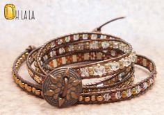 Wrap Bracelet cristaux et perles sur cuir marron avec bouton Bronze par OhlalaJewelry sur Etsy https://www.etsy.com/fr/listing/215689954/wrap-bracelet-cristaux-et-perles-sur