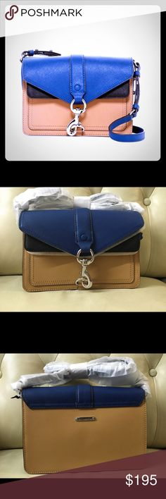 "Hudson Mini Moto Crossbody bag by Rebecca Minkoff Super cute Hudson Mini Moto Crossbody bag by Rebecca Minkoff! Colors: Navy, beige, black Multi. Dimensions: 8.75"" Lx 2.5"" Depth x 6.1"" W. Strap drop is 15 to 22.5"". Saffiano Leather. Gorgeous bag! Rebecca Minkoff Bags Crossbody Bags"