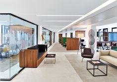 Capital 8 HQ Office Paris, France. It features custom seating veneered in plastic laminate.