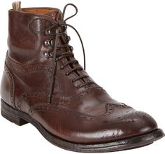 $745, Dark Brown Leather Brogue Boots: Officine Creative Wingtip Ankle Boots. Sold by Barneys New York. Click for more info: https://lookastic.com/men/shop_items/52723/redirect