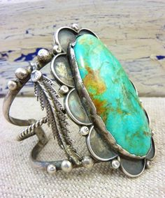 Vintage Navajo Sterling Silver Squash Blossom Cuff Bracelet w Huge Royston Turquoise Stone.