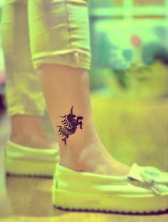 unicorn tattoo on the ankle