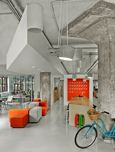 Example of concrete ceiling structure painted white  Arnold Worldwide - 2014 New York Design Awards