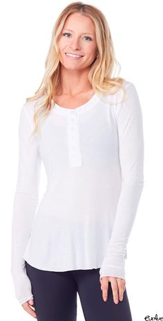 We're obsessed with this henley top from Joah Brown - comfortable, cute, and perfect for any occasion! Shop now at www.evolvefitwear.com.