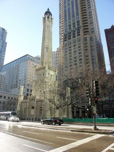 The Chicago Water Tower, built in 1869, surrounded by skyscrapers.