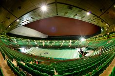 A wide angle view of Centre Court as night falls over the All England Lawn Tennis & Croquet Club. - Matthias Hangst/AELTC