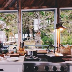 Homey Wooden Forest Cabin Kitchen // via girlpolish