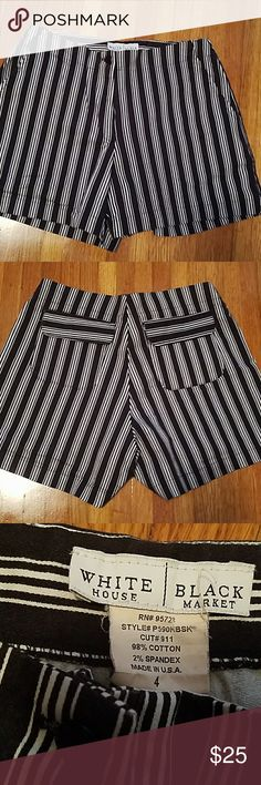 White House Black Market navy blue & white shorts White House Black Market navy blue with white pinstripes shorts. 13 inches long 4 inch inseam White House Black Market Shorts Bermudas