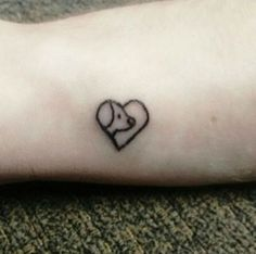 39 dog tattoos to celebrate your four-legged best friend: Two dogs heart tattoo