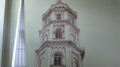 Mural w Płocku, wieża ciśnień. Malowanie na ścianie starego zabytkowego budynku