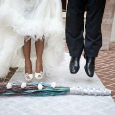 Jumping the broom, an African-American wedding tradition born out of repression, now a symbol of self-expression and cultural continuity.