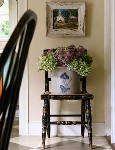 An old chair which may not be sturdy can be enjoyed as a shelf for a flower arrangements.
