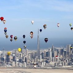 Hot air balloons fly over Dubai during the World Air Games 2015, as part of the 'Dubai International Balloon Fiesta' event on December 9th  2015. Credit: AFP/Karim Sahib  #balloons #BalloonFiesta #WorldAirGames #Dubai #skyline