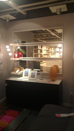 IKEA stave mirrors & floating shelves with malm chest make a great design in any space.