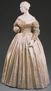 Wedding Dress Made in Philadelphia, Pennsylvania, United States 1841 Artist/maker unknown, American, Quaker. Worn by Mrs. Isaac Paschall Morris (Rebecca Thompson). Ivory figured silk Length (Dress): 48 1/16 inches (122 cm) Width across shoulders (Dress): 18 1/2 inches (47 cm)