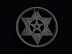 This is my favorite of all the Moroccan coins. Minted only in 1953.   A pentagram within a Star of David!  I mean, come on!