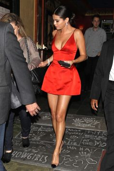 Selena looks stunning in the little red Dior dress. Nice idea for Christmas party outfit! #selenagomez #celebritystyle