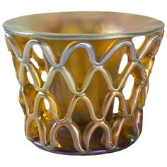 "A Tiffany Studios New York Favrile glass ""Diatreta"" vase by Louis Comfort Tiffany. The ""Diatreta"" style used on this piece was perfected by ancient Roman glass makers who would pull an exterior caging layer of latticed glass around a smooth central vessel. circa 1900."