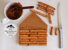 log cabin gingerbread house from a kit! just trim and add pretzels; free tutorial from www.gingerbreadjournal.com