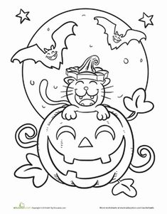 Featuring a kitty popping out of a grinning jack o' lantern, this Halloween scene is definitely more cute than scary.