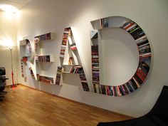 "A new dream for my classroom.  This bookcase (by an unknown designer) is made up of cut-out letters that spell the word ""read"". Could be a fun DIY project if you happen to have a wall in your classroom."