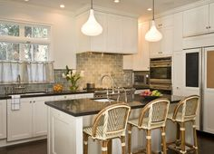 Blue green backsplash tile with white cabinets, black countertops - YES!!