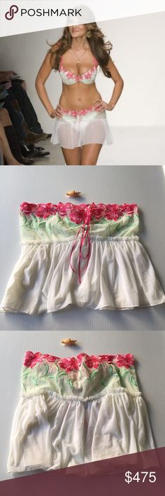 Beach bunny white pink floral lace up skirt small Beach bunny white pink floral lace up skirt size small...very rare hard to find skirt ..super sexy ..pre-loved And only used a few times ...the color is more of an off white ivory ...I also have the matching bikini for sale 💖😍✨💕 Beach Bunny Swim Coverups