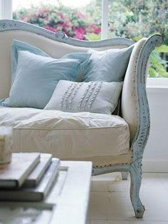 antique sofa in pale blue and natural linen by lorilondberg