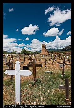 Wooden crosses and old adobe church. Taos, New Mexico, USA (color)