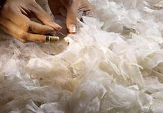 Highly skilled craftspeople working for Lemarié spend hours in the painstaking task of selecting and individually attaching feathers to dresses, handbags and hats.  They dye, thin, curl and even pound feathers to create wonderful pieces that are used in the couture process