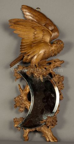 Lovely handcarved mirror made in the black forest region of Germany.....I believe it to be an owl landing in a tree, but not 100% sure.    Photo via web.....