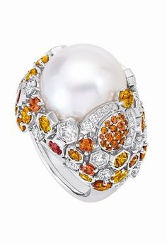 Chaumet; Grey gold Boule Lune de Miel ring with diamonds, orange and yellow sapphires, white cultured pearl centre, 30.04-carat pearl