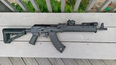 Izhmash Saiga 7.62x39      - Magpul Zhukov hand-guard&     - Magpul STR stock     - Magpul MOE+ AK grip     - Magpul AK magazine     - Magpul M-LOK Paraclip Sling Mount     - Vltor AK receiver extension     - Krebs Custom MK VI safety lever     - RAM Enhanced Speed Catch     - Tromix extended charging handle knob     - UltiMAK M1B Forward Optic Mount     - Primary Arms Micro Dot MD-RBGII     - Thorntail Offset Adaptive Light Mount     - Streamlight PolyTac LED Flashlight