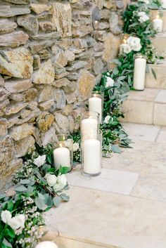 Lush greenery wedding ceremony site. Candle lined stairs. Garland and styling by LUX Wedding Florist, Phoenix, AZ. Photograph by Monique Hessler Weddings.