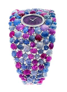 DeLaneau's Grace Stars jewellery watch is set with 118 star-cut rubies and sapphires as well as 276 diamonds. The dial is a slice of ruby known as a ruby heart, surrounded by 58 diamonds.