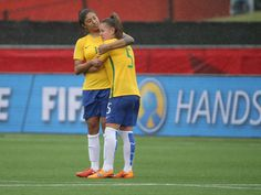 Brazil forward Cristiane, left, and midfielder Andressa console following the 1-0 loss against Australia in the round of sixteen in the FIFA 2015 women's World Cup soccer tournament at Moncton Stadium in New Brunswick.  Matt Kryger, USA TODAY Sports