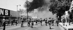 It's been 50 years since deadly violence wracked South Los Angeles. But memories of the race riots linger with residents. In Watts' decades of recovery, they see lessons for today's racial tensions. Watts Riots, Haunted America, California Highway Patrol, Los Angeles Police Department, San Diego Living, Civil Rights Movement, Miles Davis, The New Yorker, The Guardian