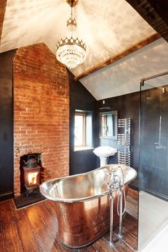 Fireplace and lighting elevate the style quotient of this gorgeous farmhouse bathroom [Design: Hart Design And Construction] Brick Bathroom, Bathroom Fireplace, Attic Bathroom, Attic Rooms, Master Bathroom, Attic Playroom, Attic Apartment, Bathroom Bath, Small Bathroom