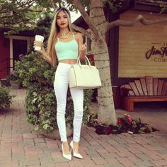mint bustier & high waisted white jeans.