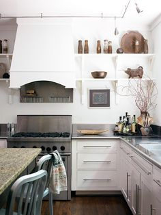 hood, stainless counter top and open shelves