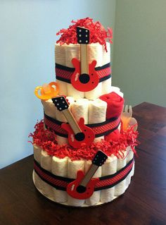 Rock Star Guitar Diaper Cake  - Three Tier Baby Shower Gift or Centerpiece boy neutral red black orange rock roll via Etsy